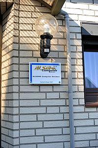 Firmenschild an Fassade, Roggenkamp 39